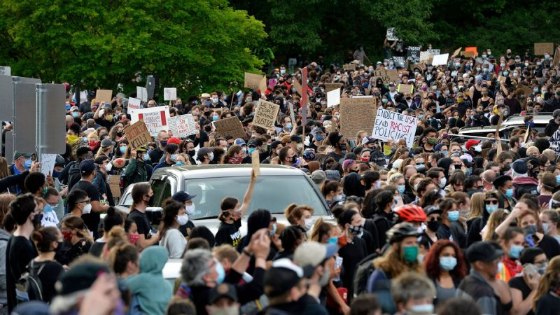 People march in a peaceful movement to protest the death of George Floyd and other black lives lost to police racism across the US at Franklin Park in Boston, Massachusetts on June 2, 2020. - Anti-racism protests have put several US cities under curfew to suppress rioting, following the death of George Floyd while in police custody. (Photo by Joseph Prezioso / AFP) (Photo by JOSEPH PREZIOSO/AFP via Getty Images)